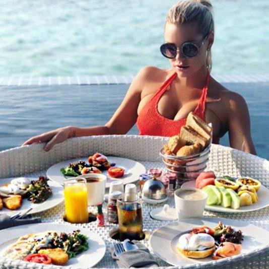 Sophie enjoys a lovers' feast on her honeymoon-style holiday with her man. *(Image: @sophiemonk Instagram)*