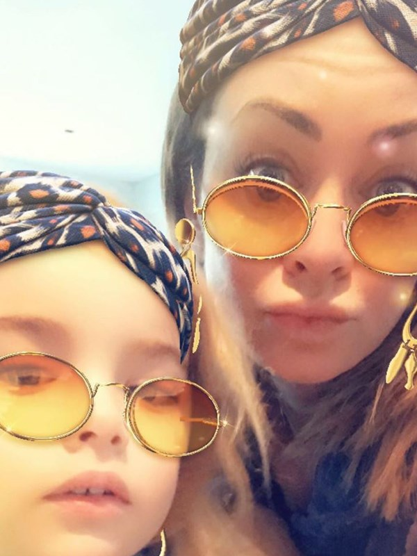 And fitness guru Michelle Bridges shared her own groovy selfie with son Axel. *(Image: Instagram @mishbridges)*