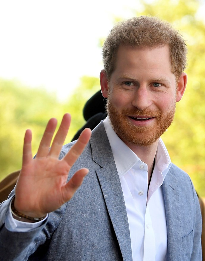 Prince Harry couldn't be more enamoured by his young son, and he wants everyone to know it! *(Image: Getty)*