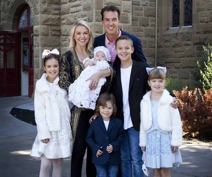 Lauren and Matt with their children Sam Monty, Eva, Lola and Perla at Perla's christening. *(Image: @pattinewtonofficial/Instagram)*