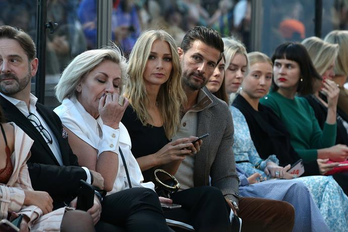 Our favourite *Bachelor* OG couple Tim and Anna Robards put on a united front for day one at the Aje show - in the front row to boot! *(Image: Getty)*