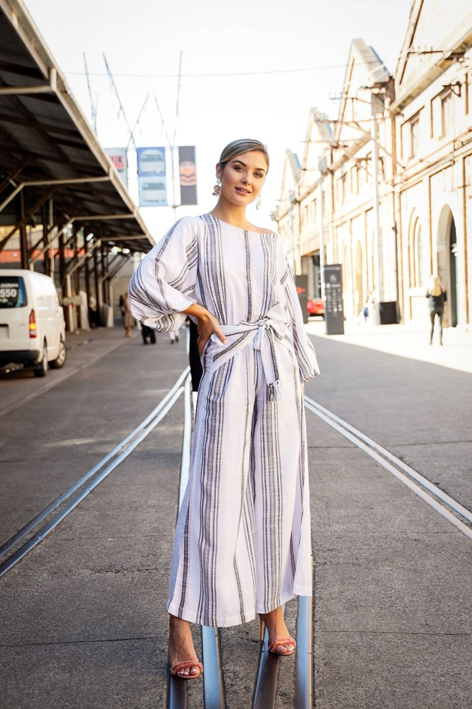 Sophie Tieman of *The Bachelor* wears a beautifully draped linen jumpsuit, tied at the waist - it's a yes from us! *(Image: Getty)*