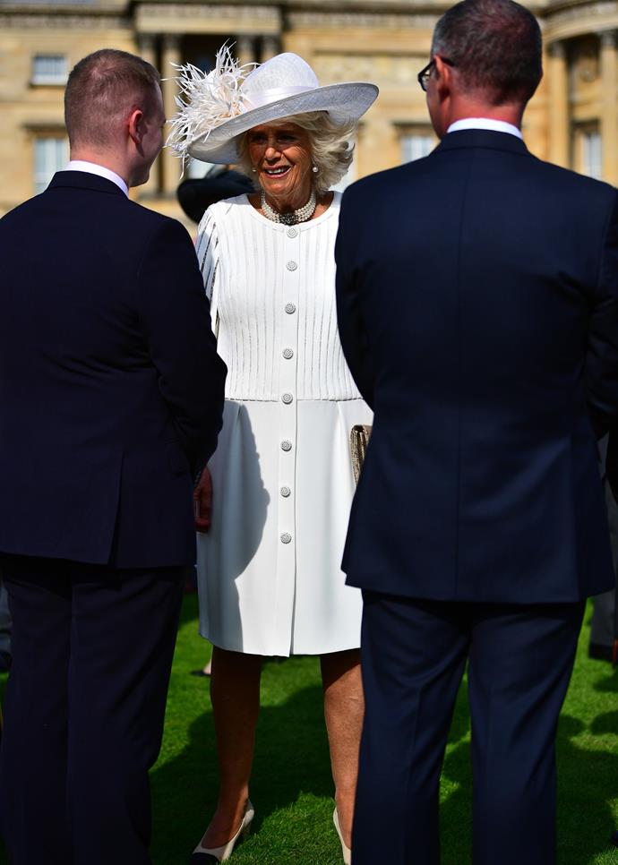 Camilla looked stunning in a white button-down Bruce Oldfield dress.
