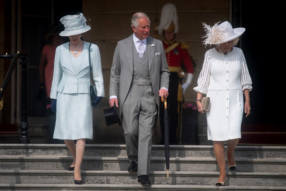 The members of the royal family make their entrance at the beginning of the garden party. *(Image: Getty)*