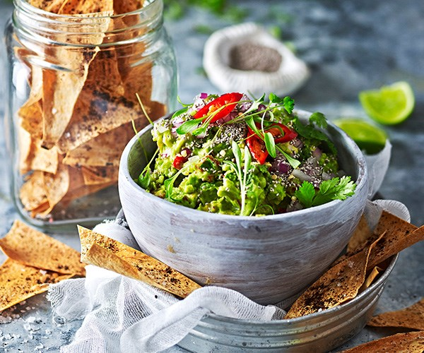 """Kick things off with this **[chia and tomato guacamole with sumac crisps](https://www.womensweeklyfood.com.au/recipes/chia-and-tomato-guacamole-with-sumac-crisps-29589 target=""""_blank"""")** for a healthy start to the night."""