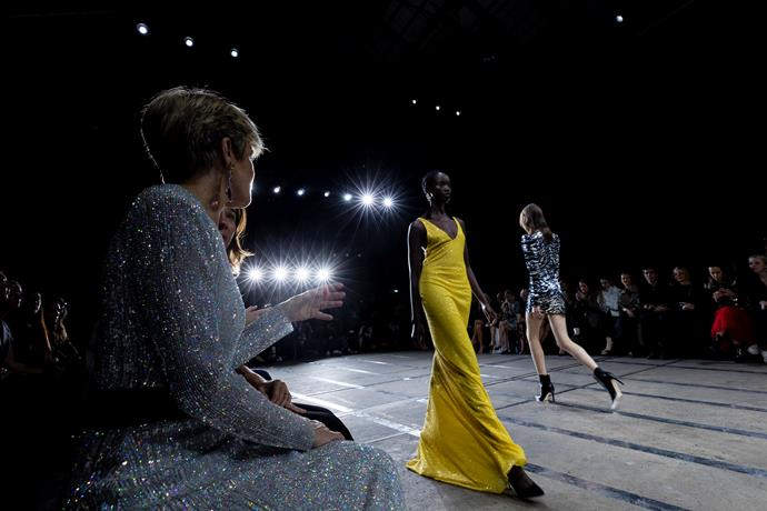 Sitting front row, Julie Bishop looked fit for the runway in this stunning designer dress.