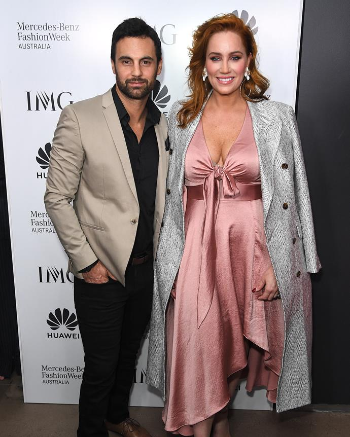 *MAFS'* golden couple Jules Robinson and Cam Merchant looked picture-perfect at the Carla Zampatti show on Thursday night at the close of Mercedes Benz Fashion Week. *(Image: Getty)*