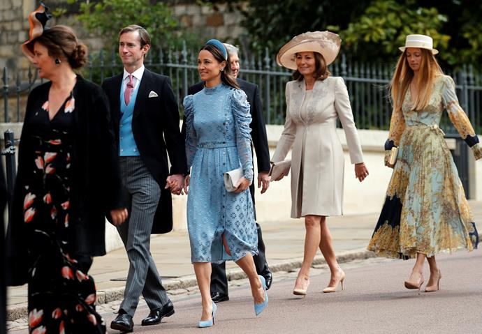 Here they come! Pippa Middleton looked stunning in a light blue dress with lace detailing - accompanied by her husband James Matthews. Meanwhile, mum Carole Middleton (pictured behind Pippa) opted for a cream ensemble - very chic!