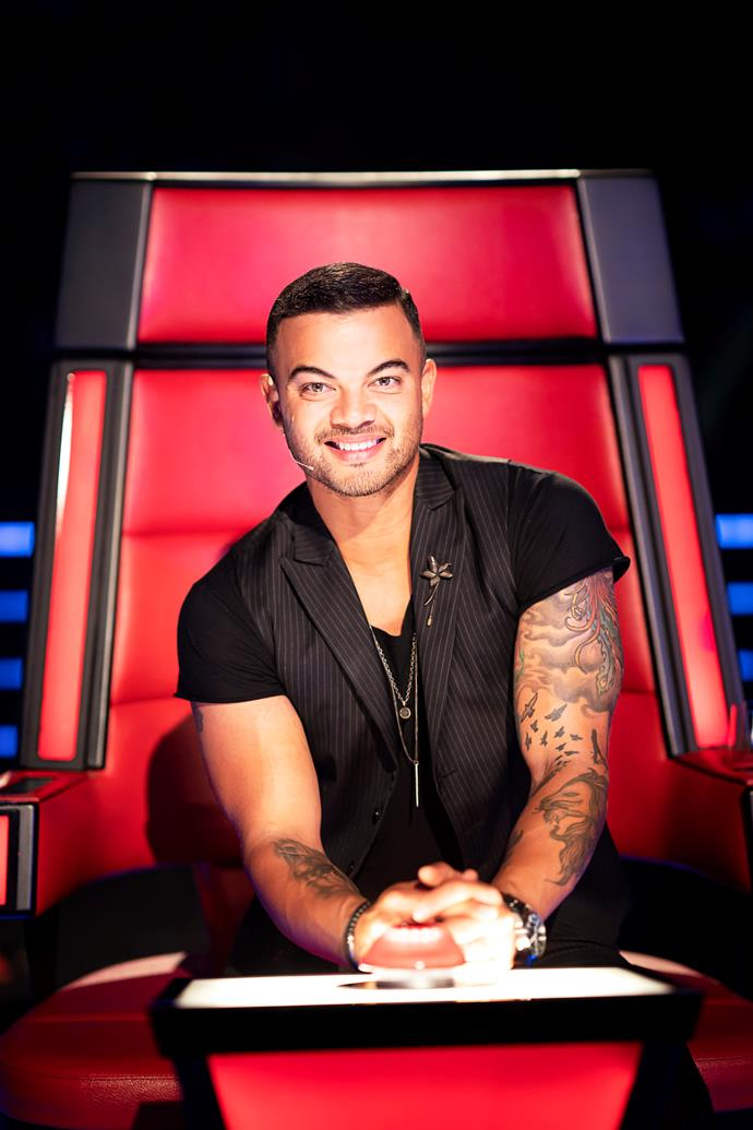 Guy gets comfy in the famous big red chair on The Voice Australia (Image: Nine Network).
