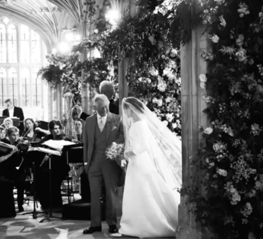 And one of our personal favourites is this stunning picture of Meghan and Prince Charles as they walk down the aisle together.