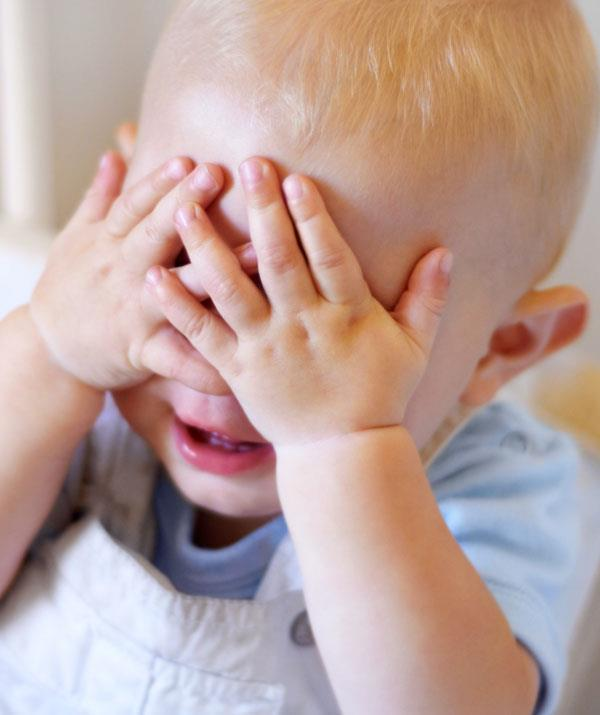 A game of peek-a-boo is ideal for a 9-month-old. *(Image: Getty Images)*