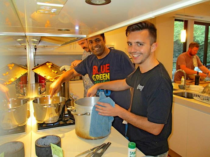 Kyle, Sandeep and Ben cook up a storm in the kitchen (Image: Supplied).