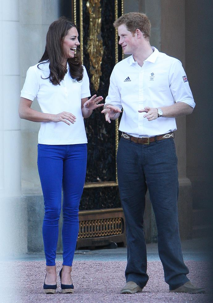 Call it what you will, but 2012 might officially have been Kate's peak skinny jeans year. These bright blue numbers she wore as she stood outside Buckingham Palace to greet the Olympic Torch are definitely loud and proud, and check out fresh-faced Prince Harry!