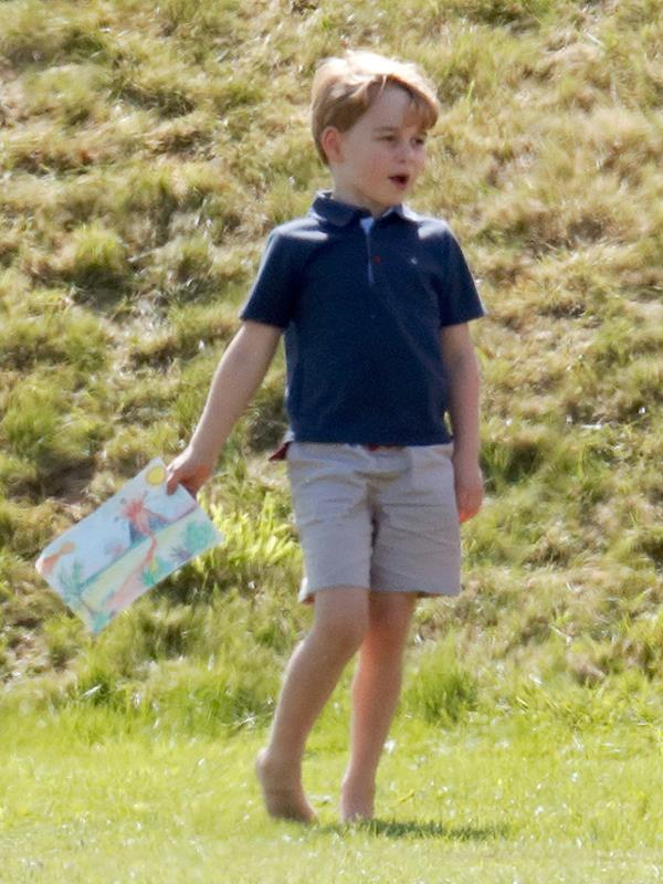 Prince George showed off his artwork at the polo in 2018.