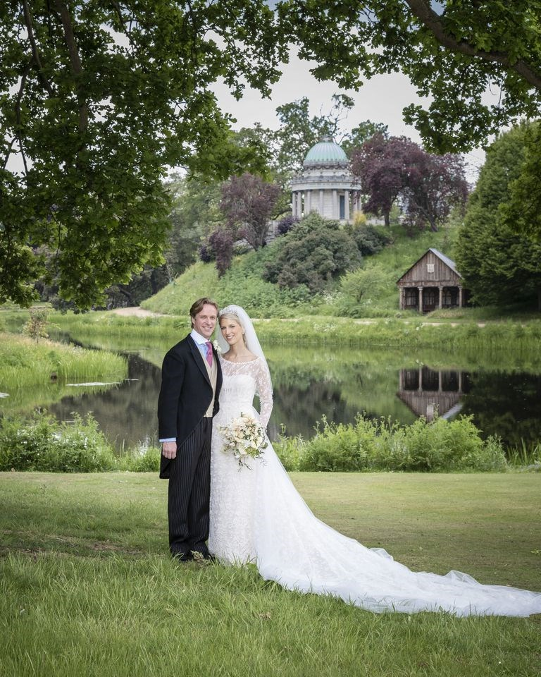 The lovely bride in groom in the gardens of Frogmore House - the same place Prince Harry and Meghan took their official engagement photographs.  *(Image: Hugo Burnand via Getty)*