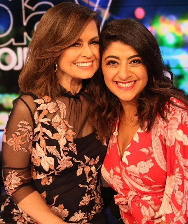"Posing next to comedian Susie Youssef, Lisa rocked a [Moss and Spy](https://www.mossandspy.com.au/|target=""_blank"") black sheer dress, which was emblazoned with blush pink floral detailing."