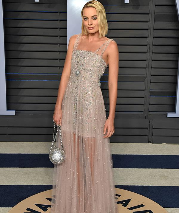 "Oh how far she has come! At the [2018 Vanity Fair Oscar's After Party](https://www.nowtolove.com.au/fashion/red-carpet/oscars-2019-red-carpet-dresses-54251|target=""_blank""), Margot's divine gown was one of the best of the night - in our humble opinion, at least..."