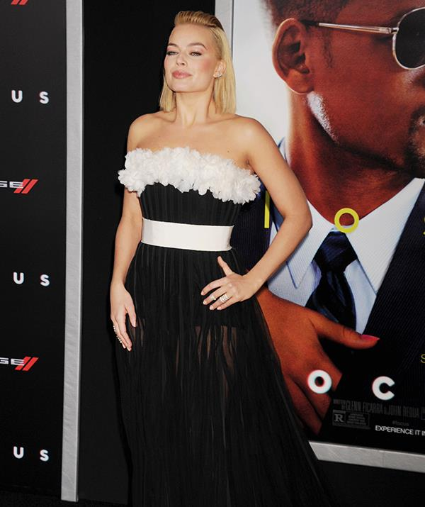 In 2015, the blonde starlet followed up her statement hairstyle with this swept-back half-up-half-down style - along with a *rather* risqué gown at the premiere of Will Smith film, *Focus*.