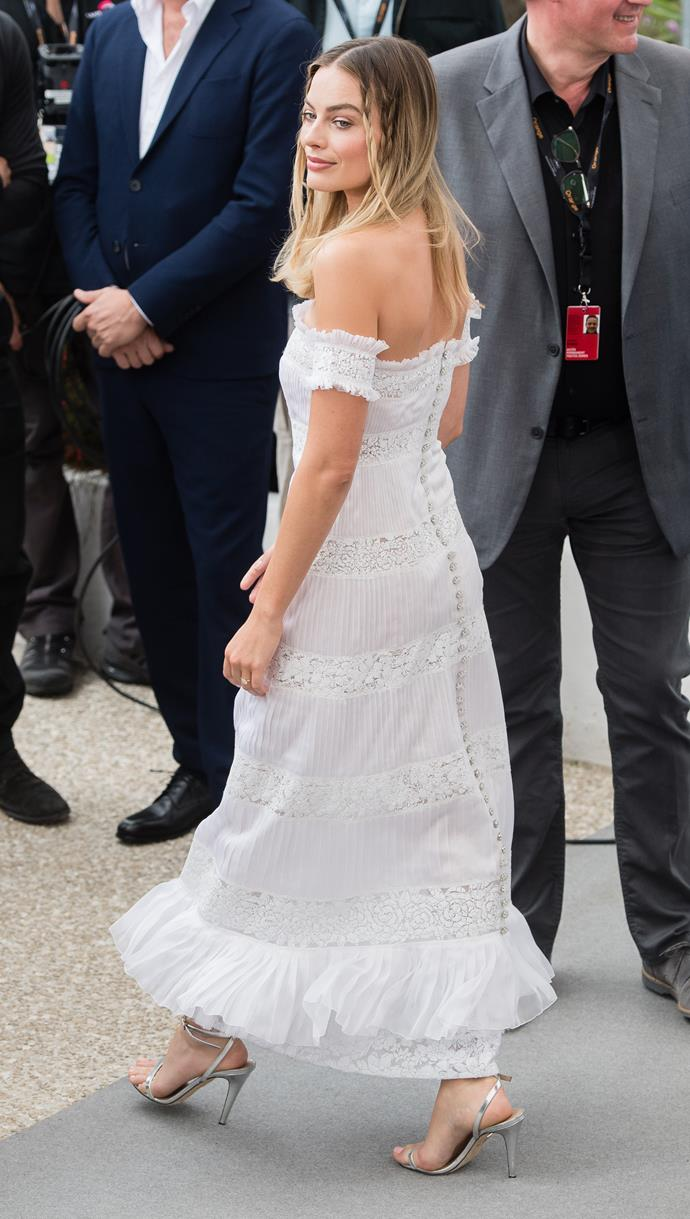 On her second day at the coveted festival, Margot went for a ruffled off-shoulder white dress - so chic!