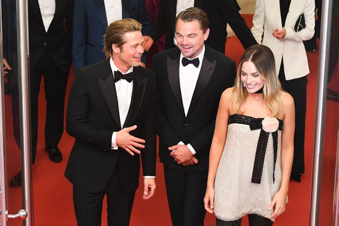 And when you're standing alongside Brad Pitt and Leonardo DiCaprio, what's not to smile about?