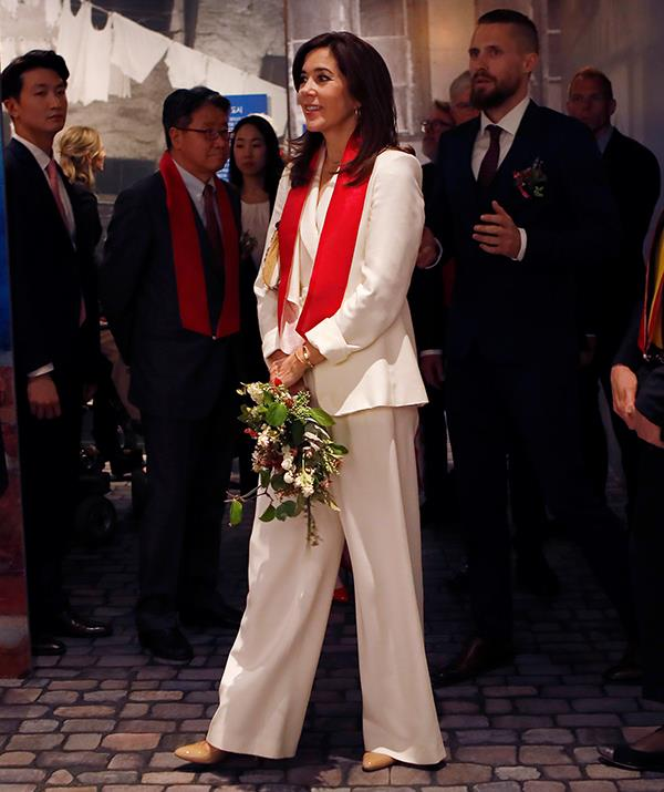 Crown Princess Mary embraced Korean culture in a beautiful white pant-suit.