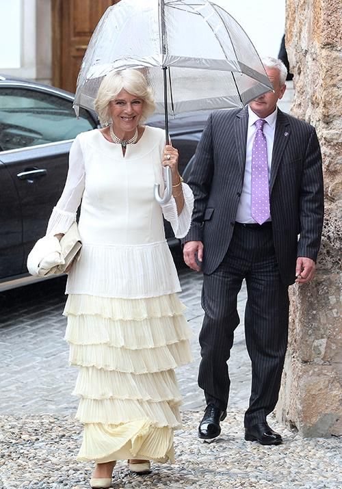 And to finish with a flourish, our all time favourite look of all: Camilla's layered white and cream dress worn for the wedding of Lady Charlotte Wellesley and Alejandro Santo in Spain, 2016. So chic!