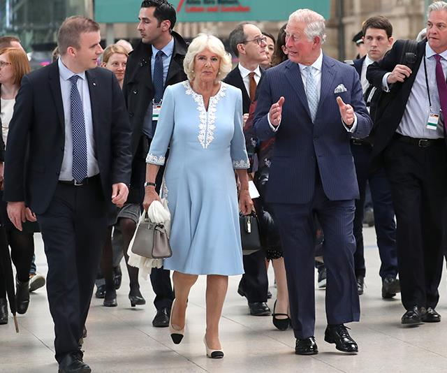 Camilla's light blue embroided dress she wore in Germany this year might look nice enough, but there's a *very* fashionable detail in here that you might have missed - those iconic Chanel heels!