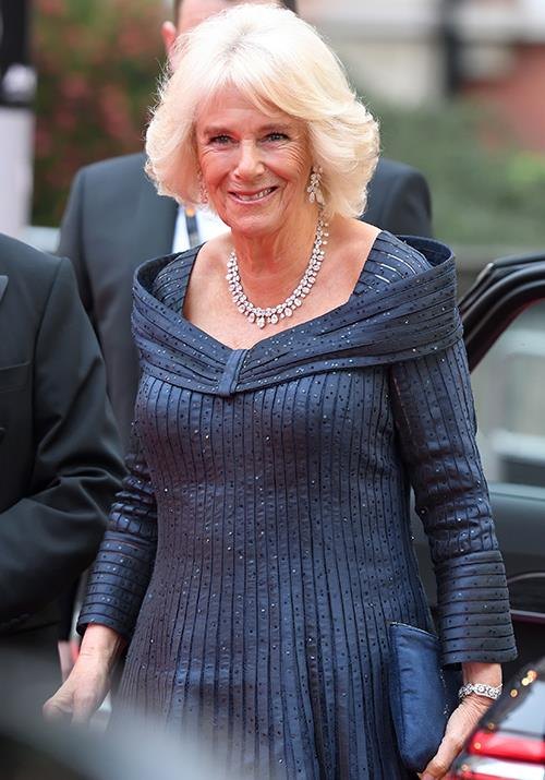 "Earlier in 2019, the stylish royal was pictured wearing this gorgeous midnight blue gown with a stunning set of jewels to finish the look off. While she picked the fitting Olivier Awards as the occasion of choice, this wasn't the first time we've seen Camilla in the beautiful gown, she also wore it to [Charles' 70th birthday celebrations](https://www.nowtolove.com.au/royals/british-royal-family/meghan-markle-kate-middleton-prince-charles-70th-52435|target=""_blank"") at Buckingham Palace in 2018!"