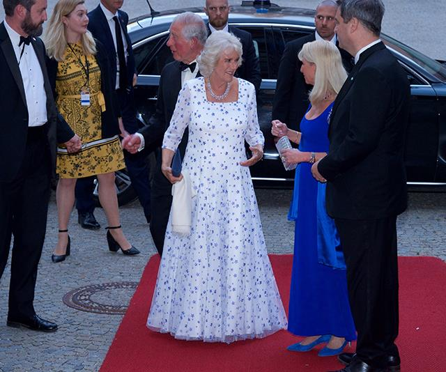 As she attended a state banquet in Germany, Camilla wore a lovely floor-length white and blue printed dress - heavenly!