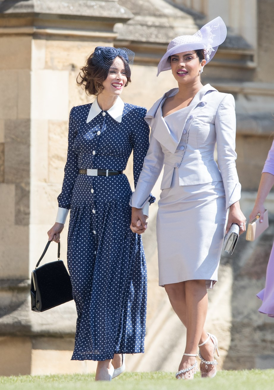Priyanka Chopra with Abigail Spencer arriving at Harry and Meghan's wedding last year. *(Image: Getty)*
