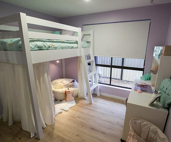 Lilac walls and a princess bed, what's not to love?