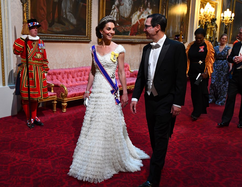 Duchess Catherine wore her blue, white and red sash of the Victorian Order for the first time at the state banquet for US President Donald Trump at the beginning of June. *(Image: Getty)*