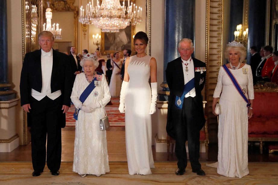 US President Donald Trump and First Lady Melania Trump with The Queen, Prince Charles and Duchess Camilla at the State Banquet on Monday evening. *(Image: Getty)*