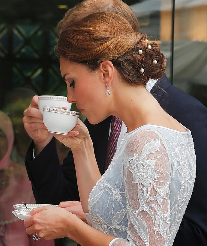 The Duchess of Cambridge drinking her tea, pinkie down!