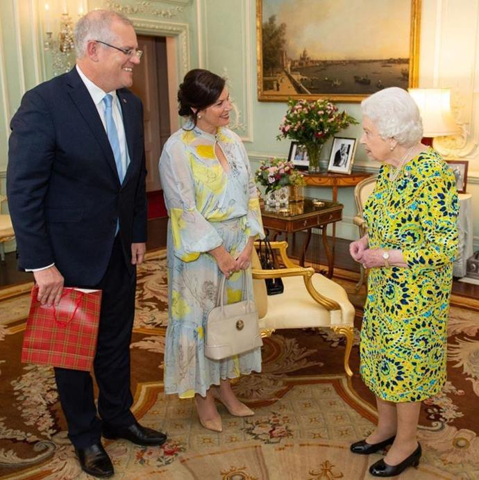Spot the handbag! Looks like the Queen was happy to be engaged in conversation with Morrison for the time being.