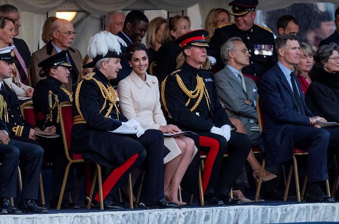 Kate looked striking in cream as she sat with members of the British military.