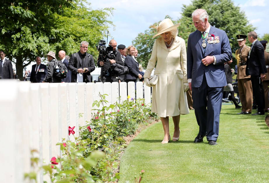 Prince Charles and Camilla paid their respect to fallen soldiers. *(Image: Getty)*