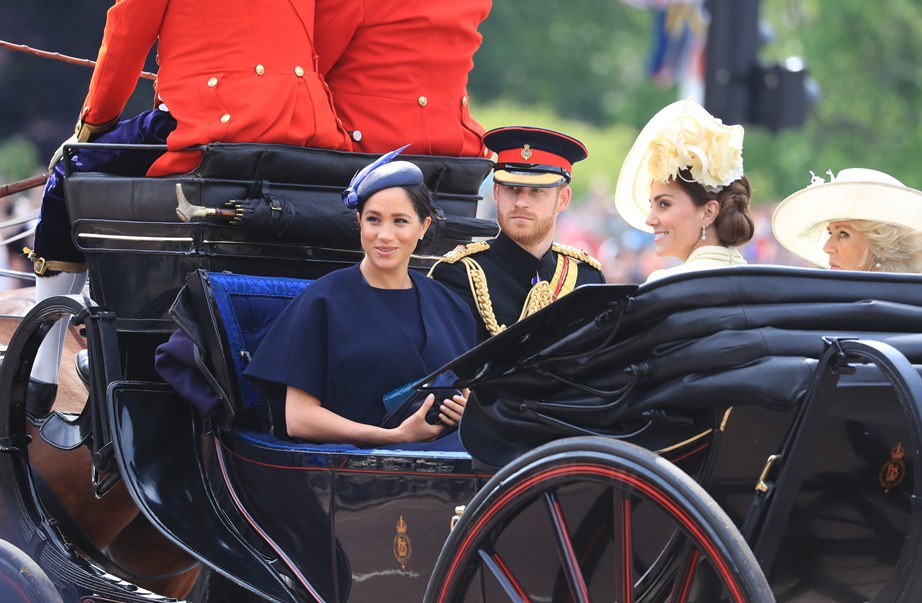 Harry and Meghan make their way to Buckingham Palace for Trooping the Colour with Kate and Camilla. *(Image: Getty)*
