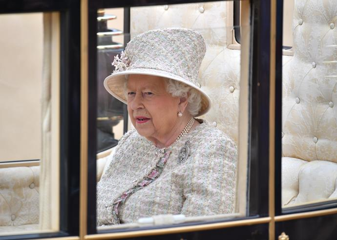 The Queen looked regal in her silver tweed look.