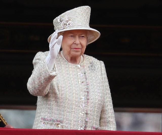 The Queen thanks for the birthday cheers with a smile and a royal wave. *(Image: Getty)*