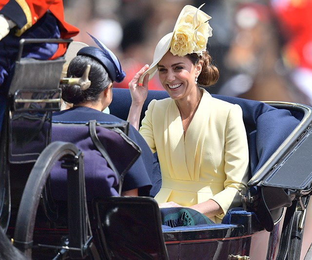 Kate shares a laugh with Meghan as they head to the Palace. *(Image: Getty)*