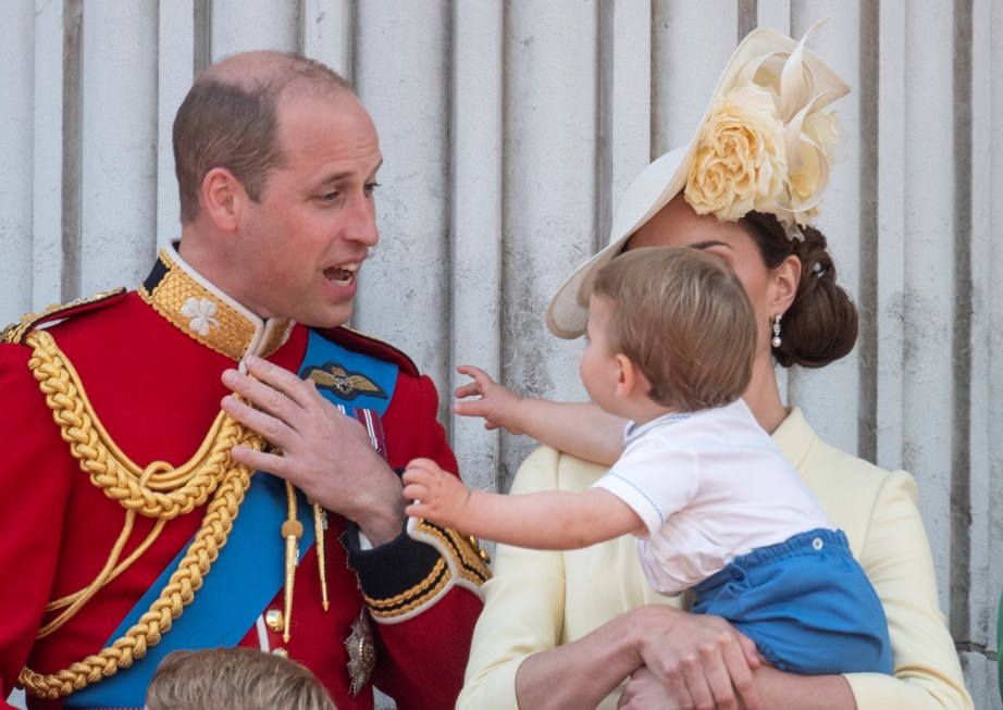 """Who, me?"" looks like Prince Louis wanted a hug from Dad. *(Image: Getty)*"