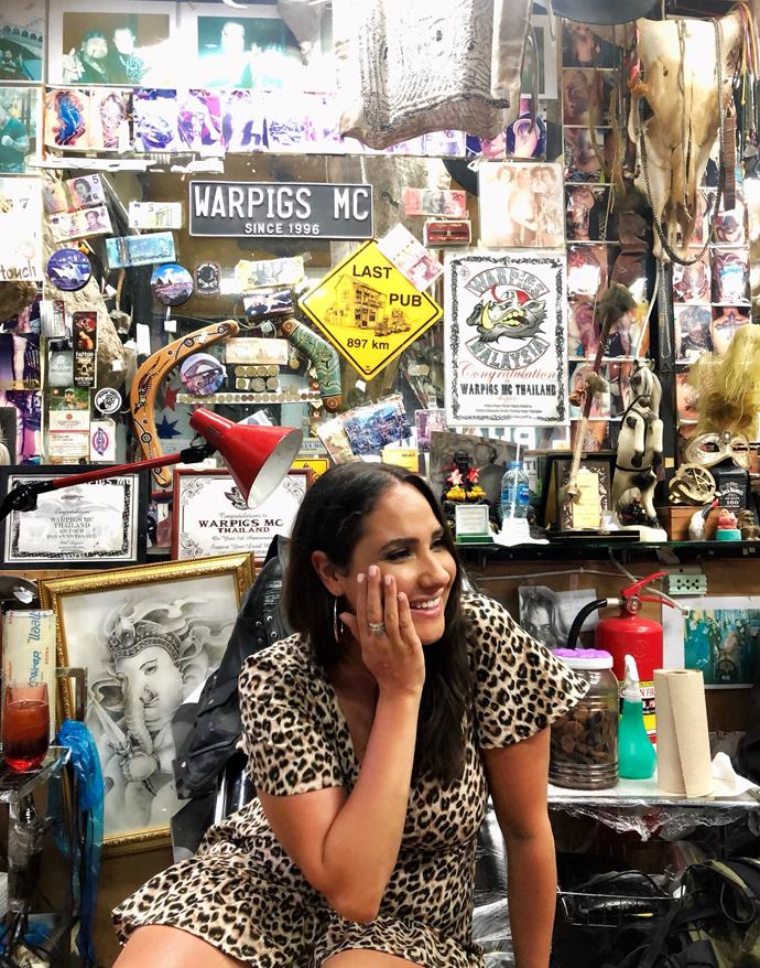 That's me sitting in a tattoo chair at Micro Tattoo, Patong. Just look at all of those signs!