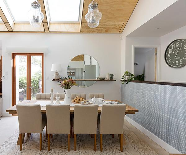 That tiled wall lifts the room!