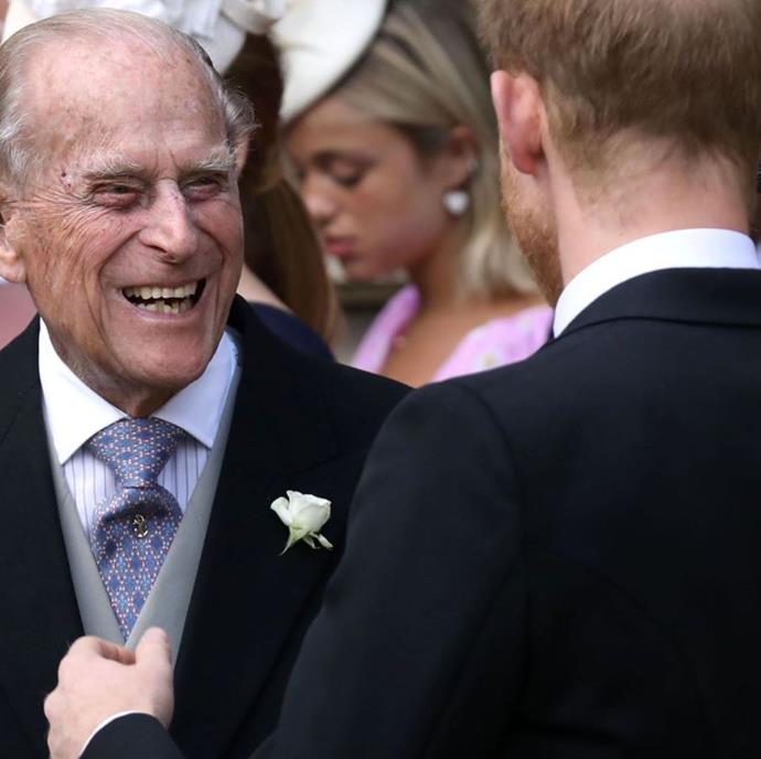 The royal family shared this sweet candid photo of Prince Philip having a laugh with his grandson Prince Harry at Lady Gabriella Windsor's recent royal wedding.
