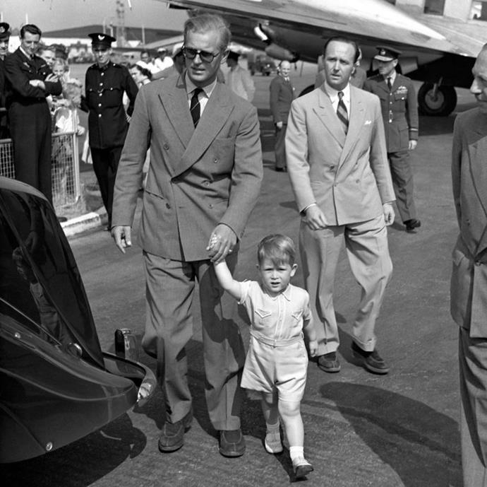 Speaking of old photos, this one could be the cutest. Clarence House shared this black and white photograph of a two-year-old Prince Charles holding his father's hand after greeting him following his return home from a trip to Malta in 1951.