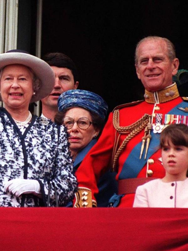 A young Eugenie stands on the balcony during one of her many Trooping the Colours.
