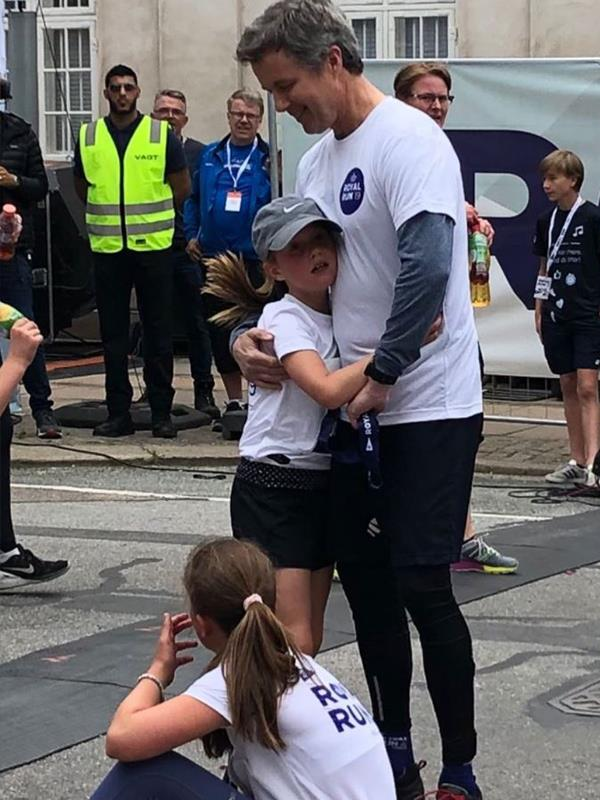 We love this candid snap of Prince Frederik giving his youngest daughter Princess Josephine a hug after the race.