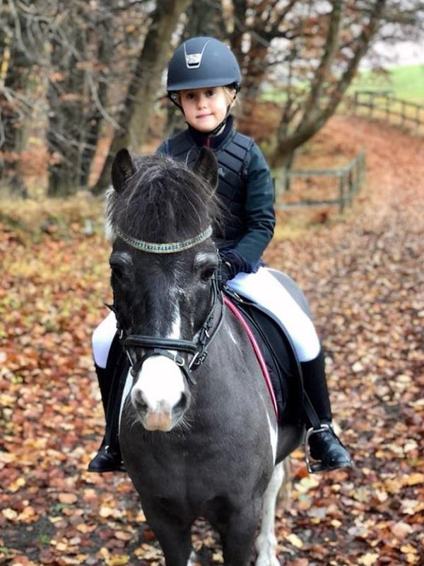 We love this picture Mary snapped herself of little Josephine riding a horse.