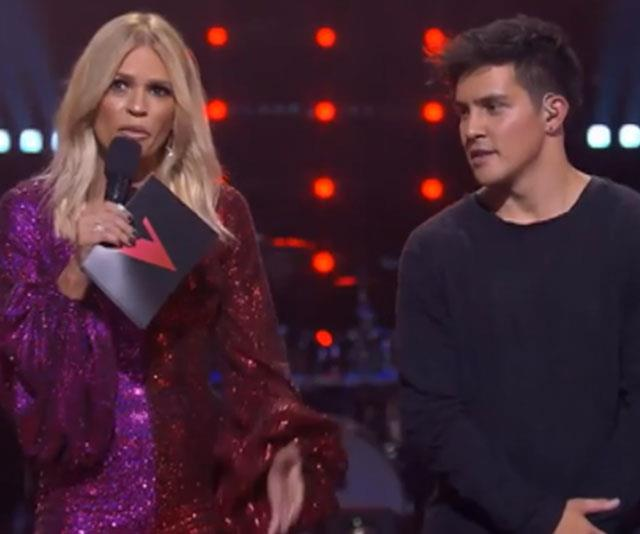 Host Sonia Kruger (left) was bidding farewell to contestant Jesse Teinaki (right) when Delta got sneaky.
